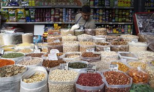 Pulses and dried fuits on sale at the Esquilino market in Rome, Italy.