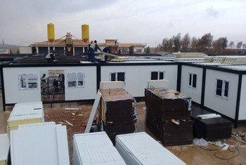 Dans les faubourgs de Mossoul, en Iraq, l'OMS construit un hôpital avec deux salles d'opération et 48 lits pour accueillir des blessés. Photo OMS