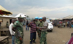 MONUSCO peacekeepers interacting with members of the local population in North Kivu province, Democratic Republic of the Congo, during an area domination mission launched in Kingi to check out the present security situation. Photo MONUSCO/Force