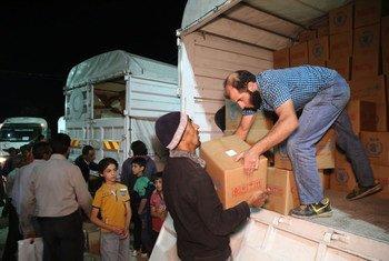 توزيع المساعدات الإنسانية في مناطق الفوعة وكفريا ومضايا والزبداني في سوريا.