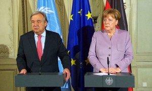 Secretary-General António Guterres (left) at a press encounter alongside German Chancellor Angela Merkel. Source: Video screen capture