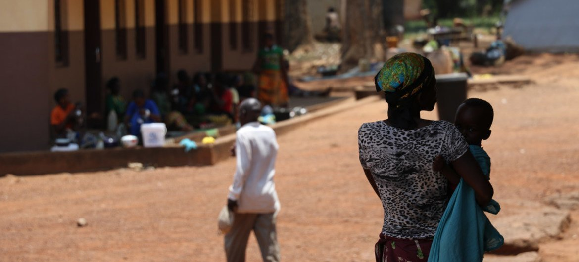 A woman holds a child in Bambari, a town in Ouaka prefecture in Central African Republic where armed group violence has caused significant population displacement. (file photo)