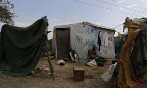 A man from the city of Sa'ada, sits outside his tent in the Dharwan settlement outside Yemen's capital Sana'a. He fled with his eight sons to the temporary settlement after his house was destroyed by Yemen's devastating conflict.