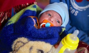 A baby displaced by the conflict in Mosul, shelter at the Qayara emergency site, in Ninewa governorate, Iraq.