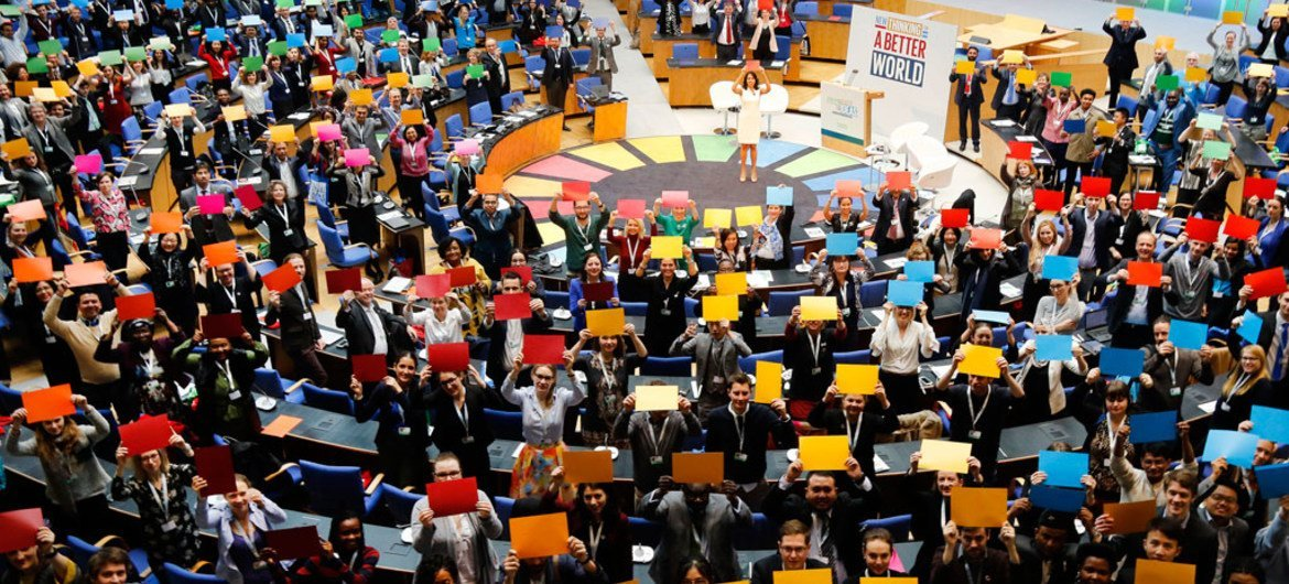 Delegates attending the Global Festival of Ideas for Sustainable Development form the SDG wheel at the World Conference Center (WCC) in Bonn, Germany.