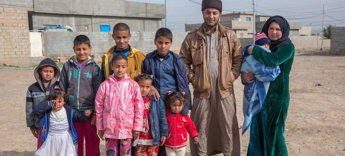 Children and their parents who were displaced from Mosul, Iraq, and now live in Kirkuk.