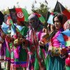 International Women's Day is being celebrated in Laghman City, where women gather in traditional colours and costumes. Photo UNAMA/Fardin Waezi