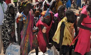 Women in Ganyiel, Unity state, South Sudan, collecting bags of food. The situation in Ganyiel is dire, with thousands of people having fled to the area from famine-stricken Leer and Mayendit counties.