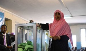 A member of the House of the People casts her vote during the election for the First and Second Deputy Speaker of the House of People of the Federal Parliament in Mogadishu, Somalia.