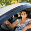 Woman in Lebanon drives a cab.
