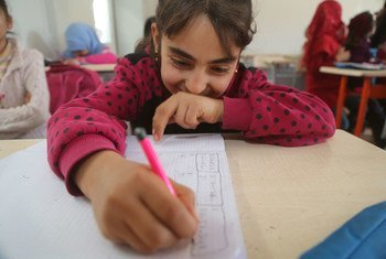 On 16 January 2017, a girl in a Turkish language class in Nizip 1 refugee camp, Gaziantep, southern Turkey. Nizip 1 camp is home to over 10,000 Syrian refugees, including more than 5,000 children.