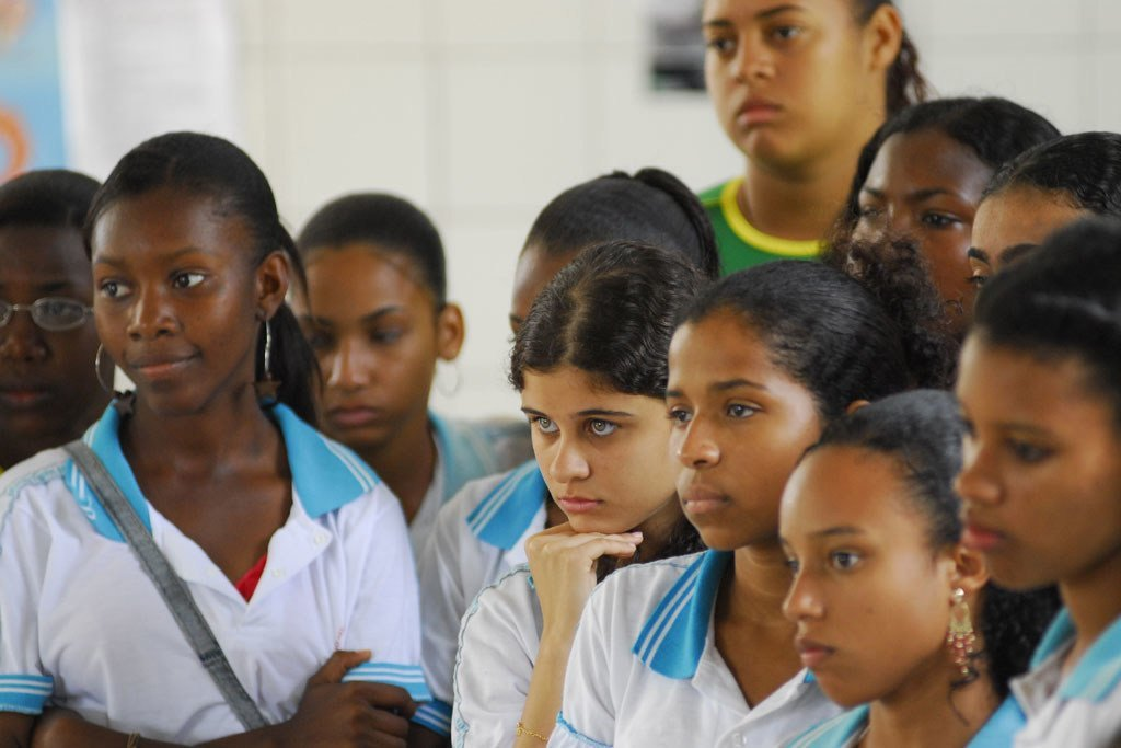 Students watch a performance by their peers at Barros Barreto School, in Salvador, Brazil. The performance tackled social issues such as racism and gender discrimination..
