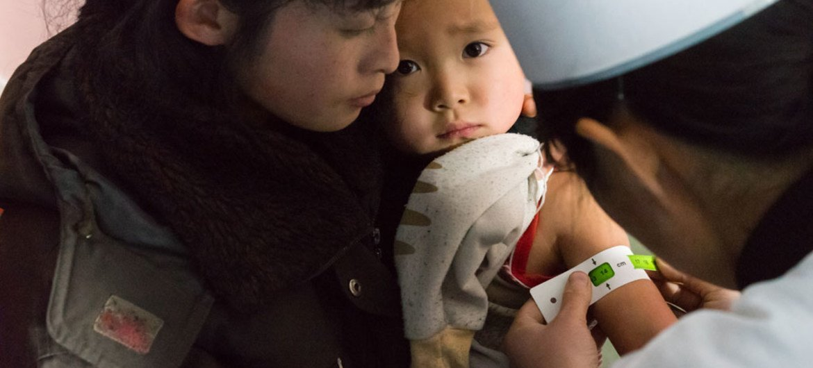 Children in a newly built clinic in Musan County, Democratic People's Republic of Korea (DPRK), are checked for malnutrition and given vaccines, Vitamin A and deworming tablets.