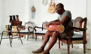 A drum maker crafts a batá drum, which is known as the sacred drum of Cuba.