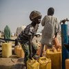 A young girl collects water for use at their home in Bakassi IDP camp, in Maiduguri, the capital of Borno state in north-east Nigeria.