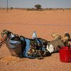 """A UN peacekeeper performing """"Battle Area Clearance"""" - finding and removing explosives - at an airstrip in Kidal, northern Mali."""