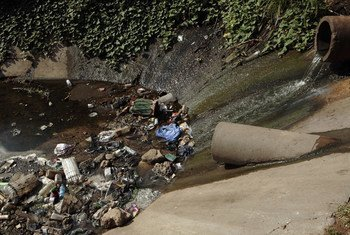 Water, along with pollutants and contaminating agents, flows into a canal in Maputo, Mozambique. (File) Photo: John Hogg / World Bank