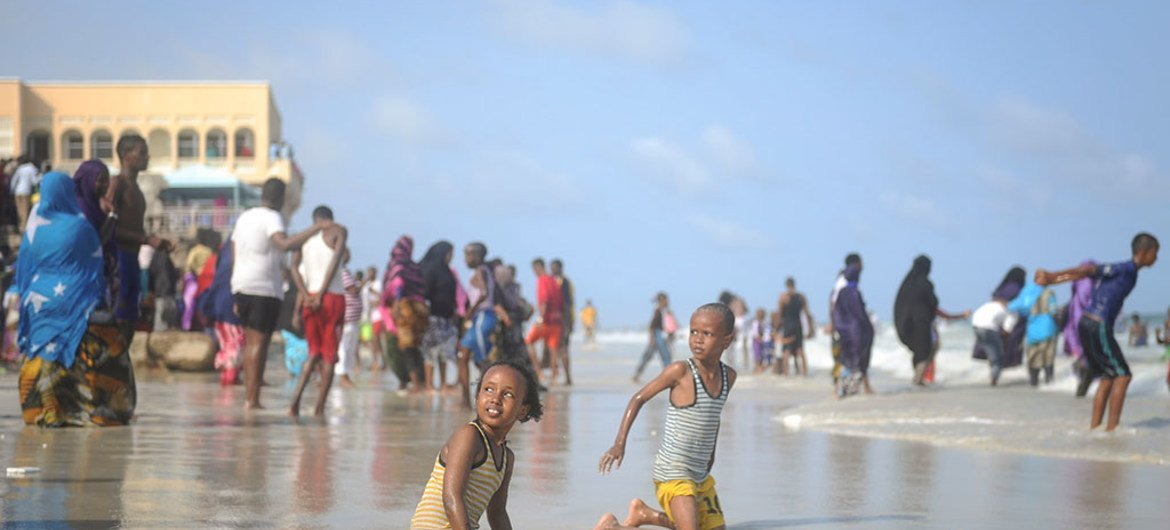 Two children play in the surf on Mogadishu's Lido beach (file)