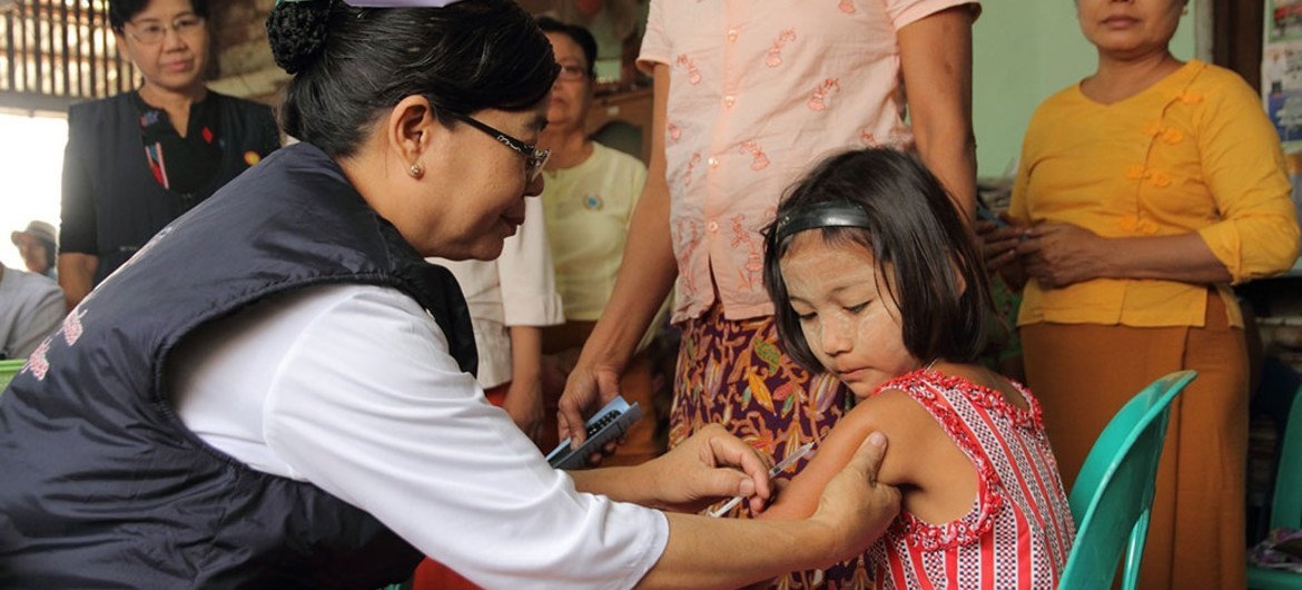 A child being vaccinated in a vaccination post established in Hlaing Thar Yar Township, Yangon, Myanmar
