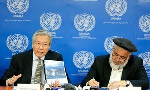 Special Representative for Afghanistan Tadamichi Yamamoto (left) and Abdul Basir Anwar, Afghanistan's Minister of Justice, launch new report on the country's progress in addressing corruption.