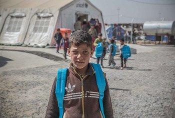 A boy inside the Qayyarah Jad'ah displacement camp, Mosul, Iraq.