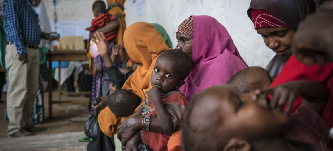 Mothers and children wait to be screened for malnutrition at a UNICEF-supported Outpatient Therapeutic Program in Baidoa, Somalia. UNICEF/Mackenzie Knowles-Coursin
