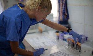 Kimberley Steeds, Ebola vaccine trial team member, in the Ebola vaccine laboratory, Donka Hospital in Conakry, Guinea.