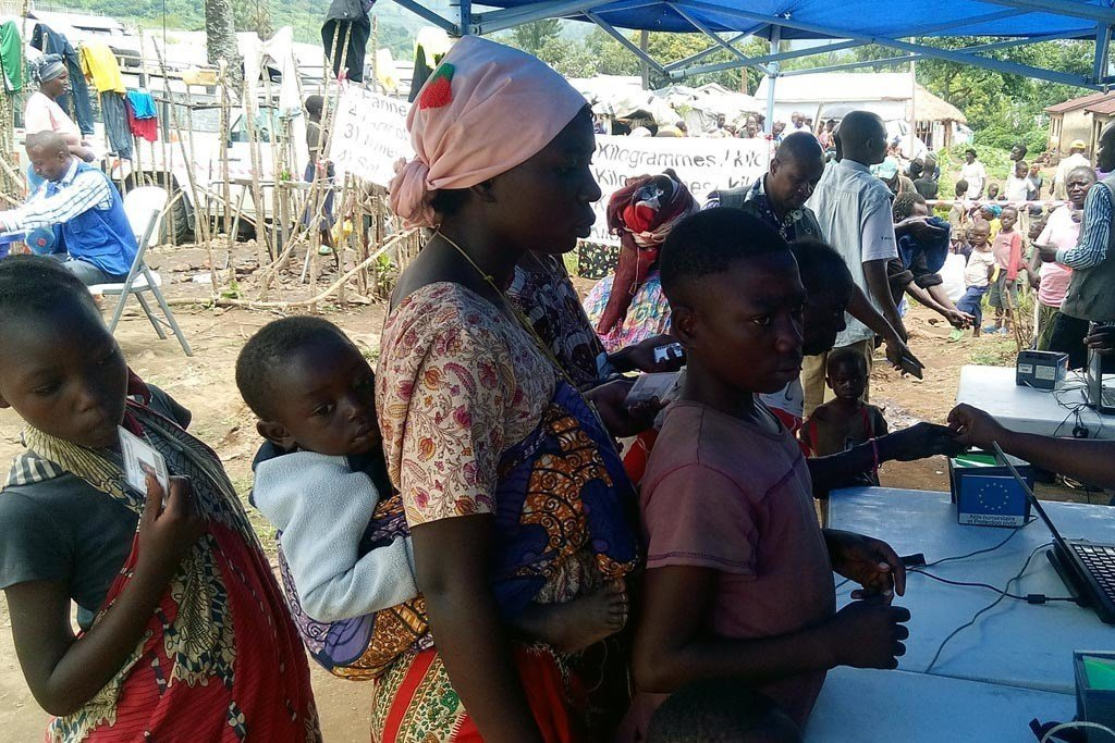 Internally displaced persons in Bweramana camp, North Kivu, Democratic Republic of the Congo, collect food items.