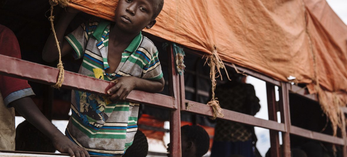 A young South Sudanese refugee looks out of a truck before being transported to the Imvepi settlement at the Imvepi Reception Centre, Arua District, in northern Uganda.