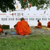 Buddhist monks meditate at the Maya Devi Temple in Lumbini, the birthplace of Lord Buddha, Nepal.
