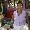 A woman in Valle, Honduras, sets up a street storefront to sell household items. She has built her business with the help of microcredit funds.