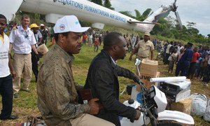 Representatives of the Ministry of Health in the Democratic Republic of the Congo (DRC), WHO and UNICEF arrive at Likati, the epicentre of the Ebola outbreak .