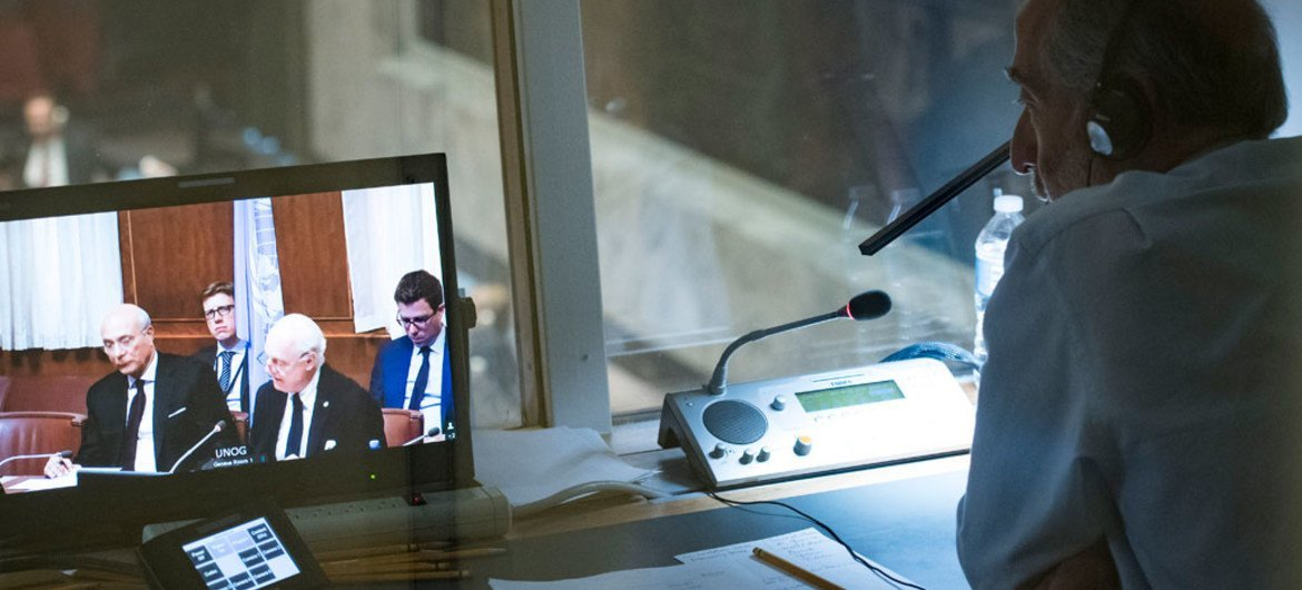 An interpreter (right) covering the Security Council meeting, as Staffan de Mistura, UN Special Envoy for Syria, briefs the Council via video teleconference.