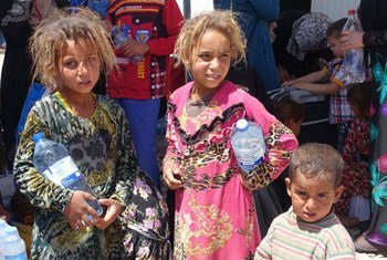 Displaced children in Hammam al-Aleel Camp, among some of the thousands continuing to flee Mosul, Iraq.