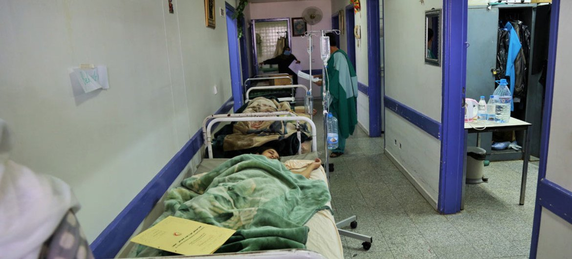 Beds are lined up in a hallway due to overcrowding in the paediatric ward at Al-Thawra Hospital, Sana'a, Yemen.