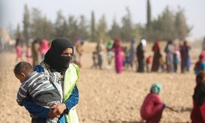 Displaced men, women and children after fleeing ISIL-controlled areas in rural Raqqa to Ain Issa, the main staging point for displaced families, some 50 Km north of Raqqa city (November 2016).