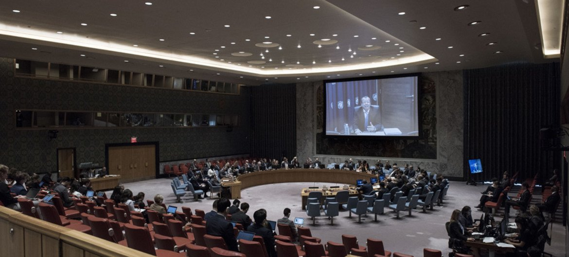 A wide view of the Security Council Chamber as Martin Kobler (shown on screen), Special Representative of the Secretary-General and Head of the UN Support Mission in Libya (UNSMIL), briefs the Council via video teleconference.