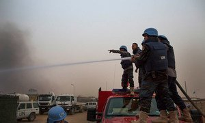 Firefighters from MINUSMA battle flames after an mortar attack on its camp in Kidal, 8 June.