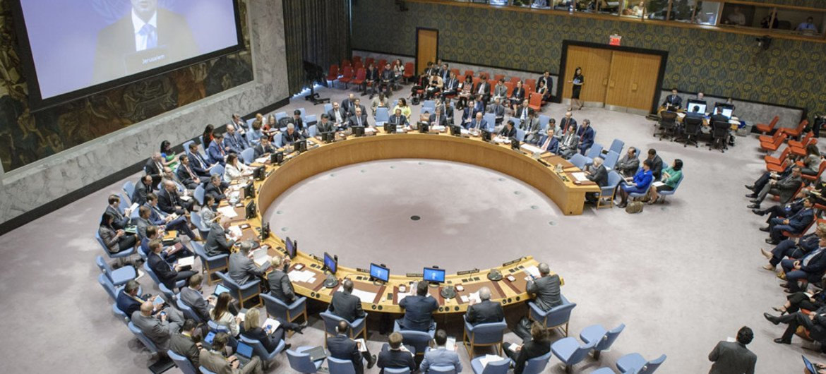 Wide view of the Security Council meeting on the situation in the Middle East, including the Palestinian question. Nickolay Mladenov (shown on screen), UN Special Coordinator for the Middle East Peace Process, briefs the Council via video conference.