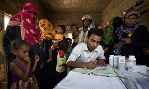 A medical worker registers young patients in the small rural village of An-Nassiri, located about 60 km from Al Hudaydah, Yemen. Only 45 per cent of health facilities in the war-torn country are currently functioning.