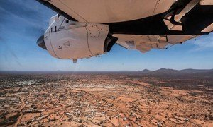 On a UN Humanitarian Air Services (UNHAS) aircraft before landing in Dinsoor, central Somalia.