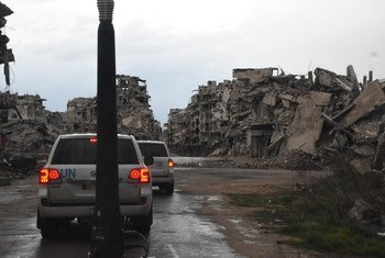 A UNICEF convoy makes its way past destroyed buildings in Homs, Syria.