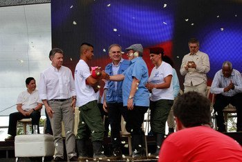 President Juan Manuel Santos; Special Representative of the Secretary-General Jean Arnault; and head of the FARC-EP Secretariat Timoleon Jimenez at a ceremony for the final laying down of weapons in Colombia.