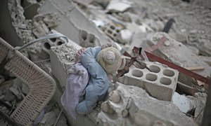 A child's plush toy lies in the rubble of a destroyed building in rural Damascus, Syria. (File)