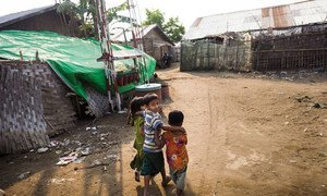 Children walk on a path between shelters at a camp for displaced people in Rakhine State, Myanmar, Thursday 6 April 2017. Most of the the displaced people are women and children.