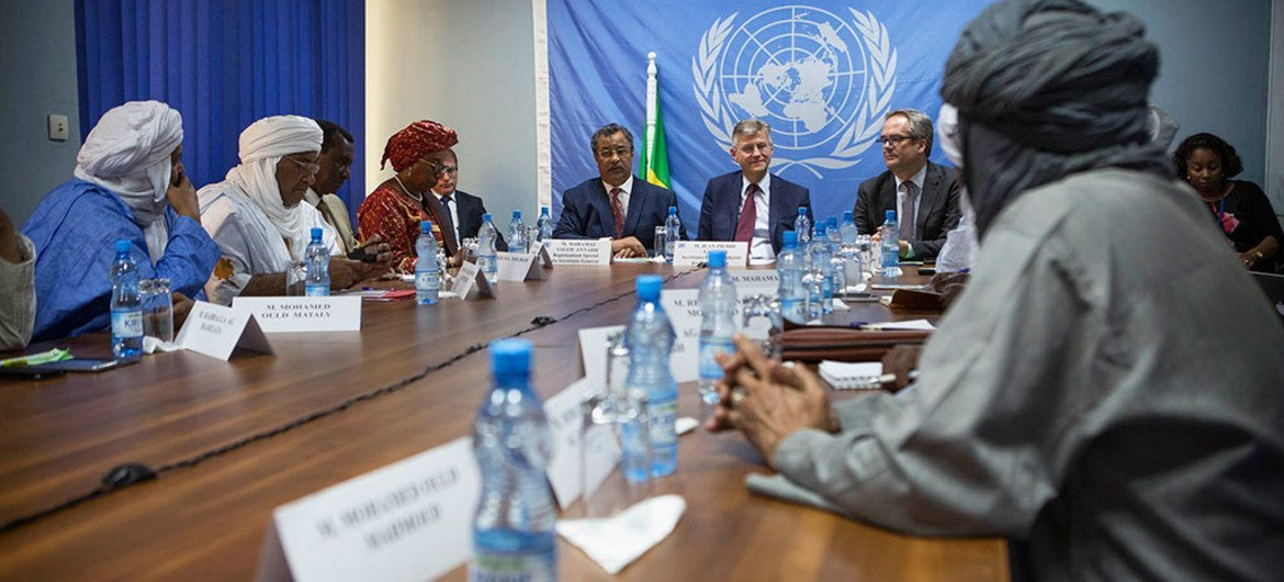 Representatives of of the signatory groups (Plateforme and CMA), pictured here in the foreground, meet with the head of the Department of Peacekeeping Operations, Jean-Pierre Lacroix (center) and Mahamat Saleh Annadif (left), head of MINUSMA, in May 2017.