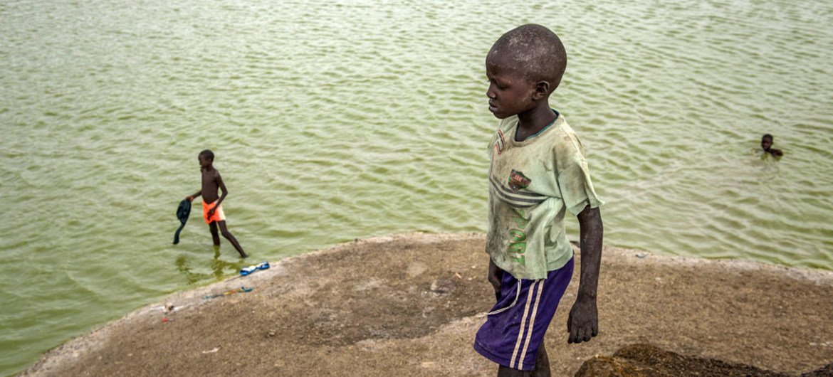 Children bathe in a lake formed by excavation pits in Bentiu, South Sudan. Nationwide, only 41 per cent of children have access to safe, clean water.