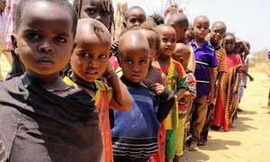 Children lining up for their one meal per day at a school in Bandarero, Northern Kenya.