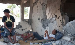 Yemeni family in their destroyed home.