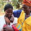 Mama na mwana wapewa chanjo. Chanjo nyingi hutokea baada ya milipuko ya magonjwa  kama vile Polio, Kipindupindu na magonjwa mengine.